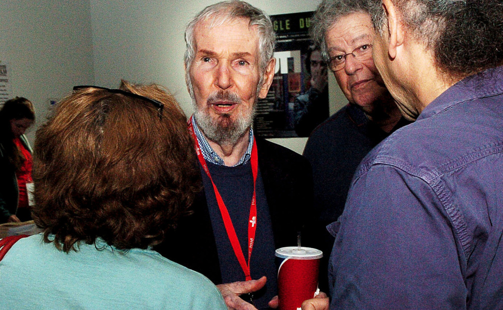 Film Director Robert Benton, center, speaks with Lea Girardin and Abba Lessing in the lobby of the Railroad Square Theater in Waterville on Sunday. Benton, this year's Maine International Film Festival Lifetime Achievement award winner, introduced his film