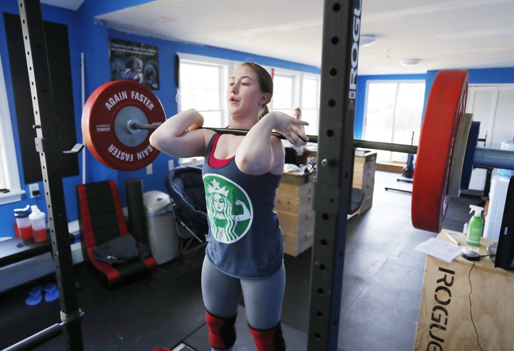 Until seventh grade, Emily McNally's focus was on basketball. But after suffering a pair of concussions in one day and spending more than a year in recovery, she took up weightlifting.