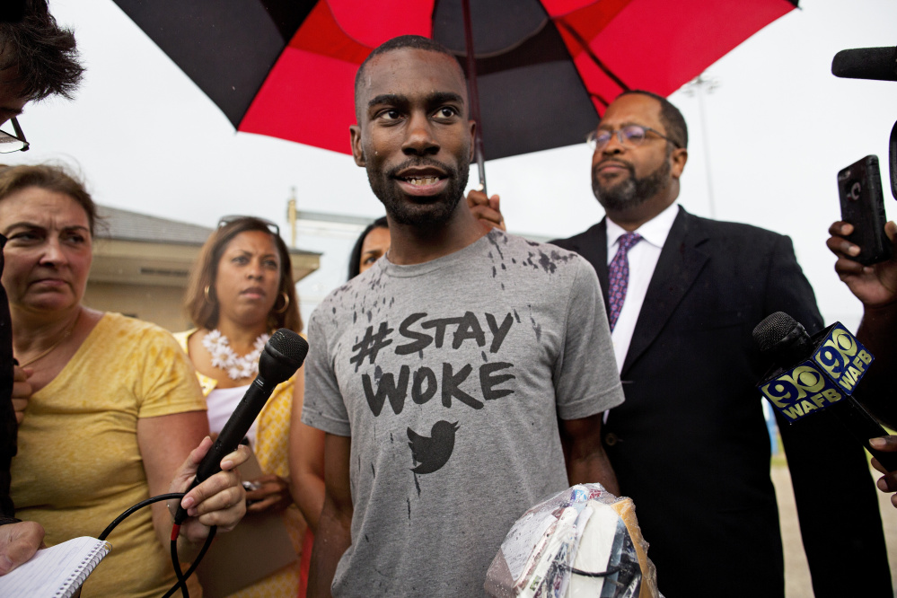 Black Lives Matter activist DeRay Mckesson talks to the media after his release from the Baton Rouge jail in Louisiana on Sunday. AP Photo/Max Becherer