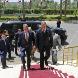 Visiting U.S. Defense Secretary Ash Carter, center left, accompanied by the Iraqi Defense Minister Khaled al-Obeidi, center right, arrives to the Ministry of Defense in Baghdad, Iraq. As Carter arrived in Iraq, Monday, he said U.S. and coalition forces will use the newly retaken air base in Qayara as a staging hub as Iraqi security forces move closer to the long-awaited battle to recapture Mosul from Islamic State militants.