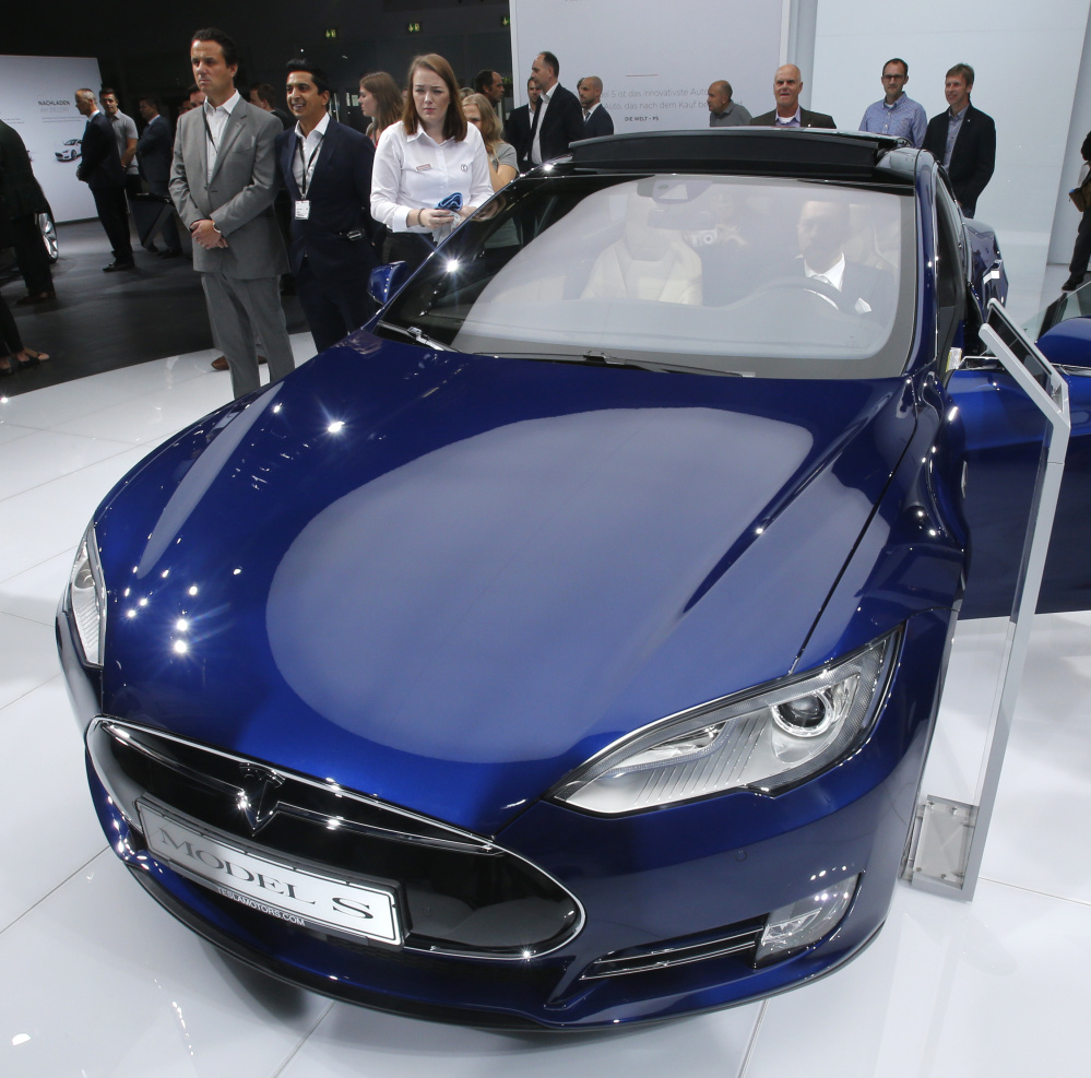 Federal officials said the driver of a Tesla Model S sports car using the vehicle's automated driving system was killed in a collision with a truck in Florida on May 7.