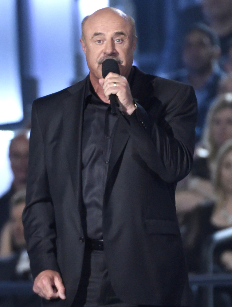 Dr. Phil McGraw says that The National Enquirer has damaged his reputation.