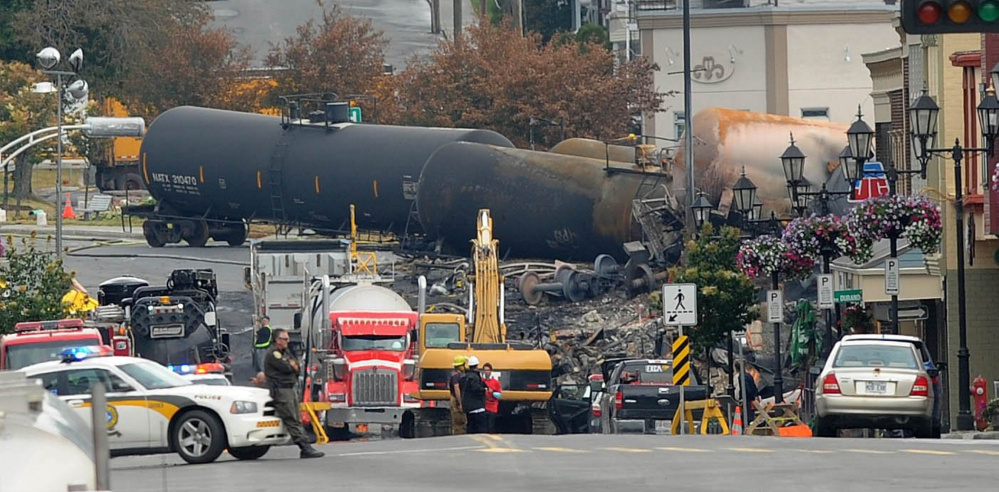 Crude oil tankers from the Montreal, Maine & Atlantic Railway are seen July 9, 2013 in the heart of downtown Lac-Megantic, Quebec, where the runaway train exploded, killing 47.