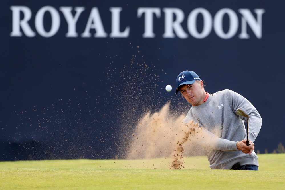 Jordan Spieth plays out of a sand trap Wednesday on the 18th green during a practice round prior to the British Open which starts Thursday at the Royal Troon Golf Club in Troon, Scotland.