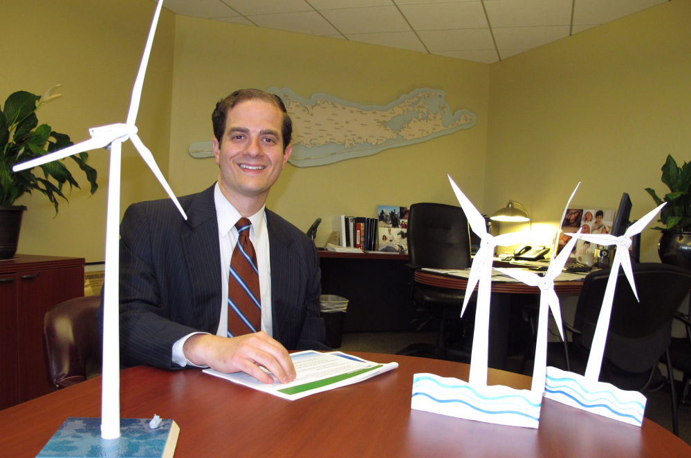 Long Island Power Authority Chief Executive Officer Thomas Falcone sits in front of some models of offshore wind turbines at the utility's offices in Uniondale, N.Y. The utility is moving forward with plans to construct the nation's largest wind energy farm off eastern Long Island.