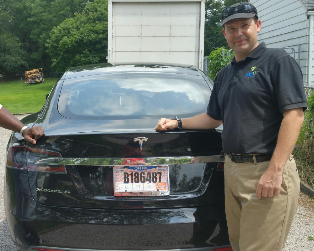 Joshua Brown stands by his new Tesla electric car near his home in Canton, Ohio. Brown died in an accident in Florida in the first fatality from a car using self-driving technology.