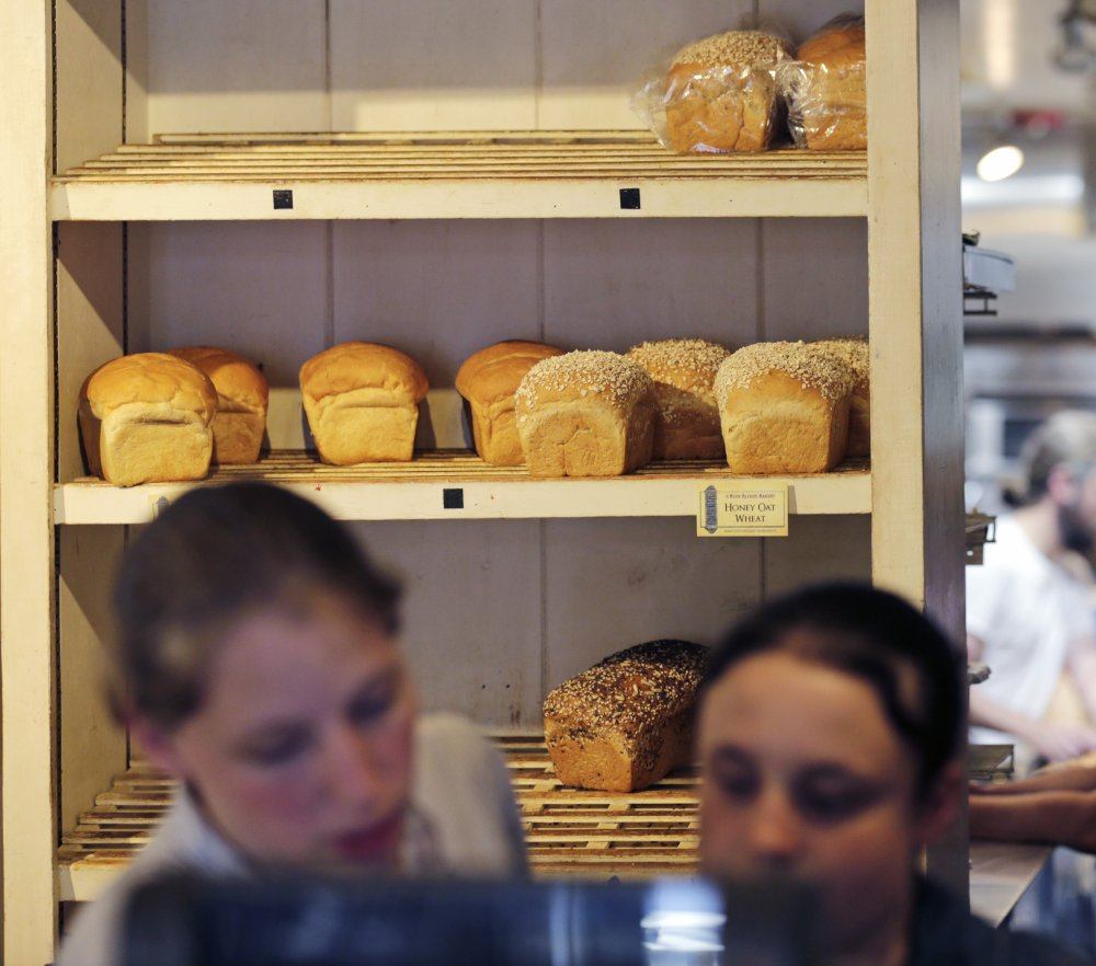 Many regular customers say allegations against the Blue Blinds Bakery won't dissuade them from cominy by for freshly baked breads as well as homemade pastries at the sect-run cafe.