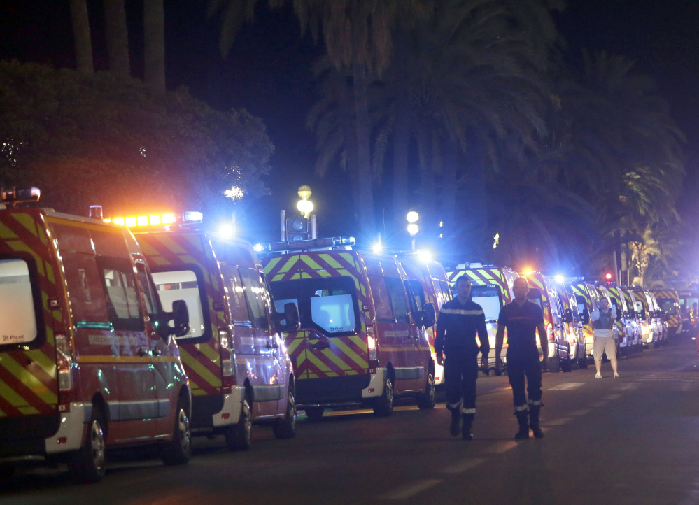 Ambulances line up near the scene of Thursday's attack on the Promenade des Anglais in Nice, France, a street lined with palm trees and grand hotels.