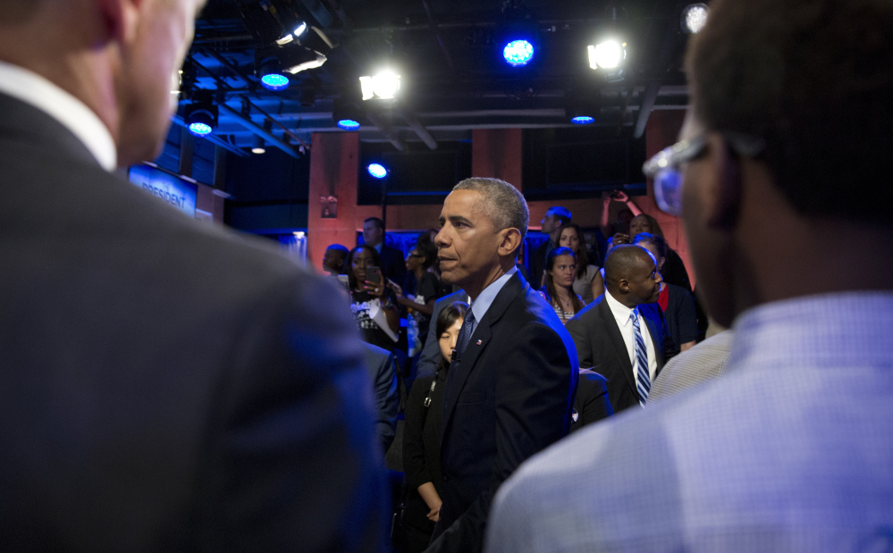 President Obama greets audience members after participating in a town hall discussion taped with ABC news anchor David Muir in Washington Thursday.