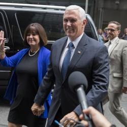 Indiana Gov. Mike Pence and his wife Karen arrive to meet with Republican presidential candidate Donald Trump at Trump Tower in New York on Friday. Trump has chosen Indiana Pence as his running mate, adding political experience and conservative bona fides to his Republican presidential ticket.