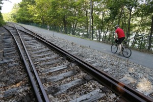 James Grecenko rides his bike along the Kennebec River Rail Trail on Wednesday in Hallowell.