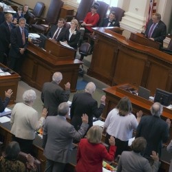 Gov. LePage administers the oath of office to newly elected legislators at the State House in Augusta in 2014. In Maine, dark money spending jumped from just $16,000 in 2006, the last election before the Citizens United decision, to $1.6 million in 2014.