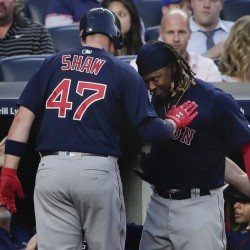 Boston's Travis Shaw celebrates with Hanley Ramirez after hitting a two-run home run against the New York Yankees in the fifth inning Friday night in New York.