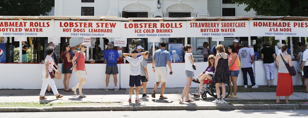 Visitors to the Yarmouth Clam Festival check out food options outside the First Parish Church Saturday.