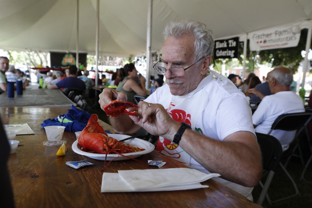 Joe Carlino of Waltham, Mass., chows down Saturday after running the 5-mile road race.