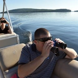 Richard LaBelle, right, and Steven Schoeneck observe a loon Saturday on Great Pond in Rome. Last year's Maine Audubon count showed numbers had doubled since the first count in 1984.