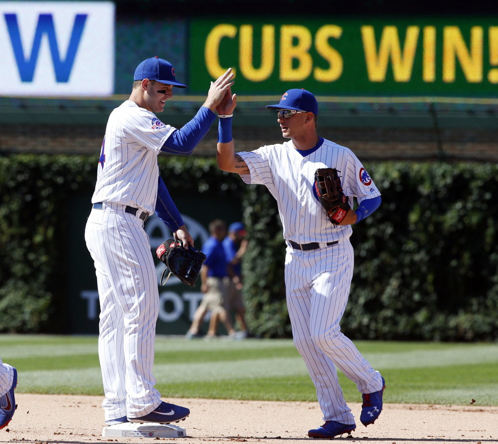 Anthony Rizzo, left, of the Chicago Cubs greets Albert Almora Jr. after the Cubs beat the Texas Rangers 3-1 in an interleague game Saturday in Chicago.