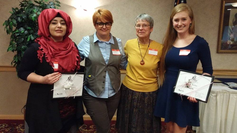 Doaa Khalil, left, of Westbrook High School, and Maude Meeker, right, of Bonny Eagle High School recently received scholarships from CCREA, presented by Marianne Pillsbury, second from left, and Muriel Allen.