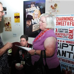 Railroad Square Cinema co-owner Alan Sanborn speaks Sunday with movie patron Pat Clark, a Unity resident who said she saw 25 films at this year's international festival.