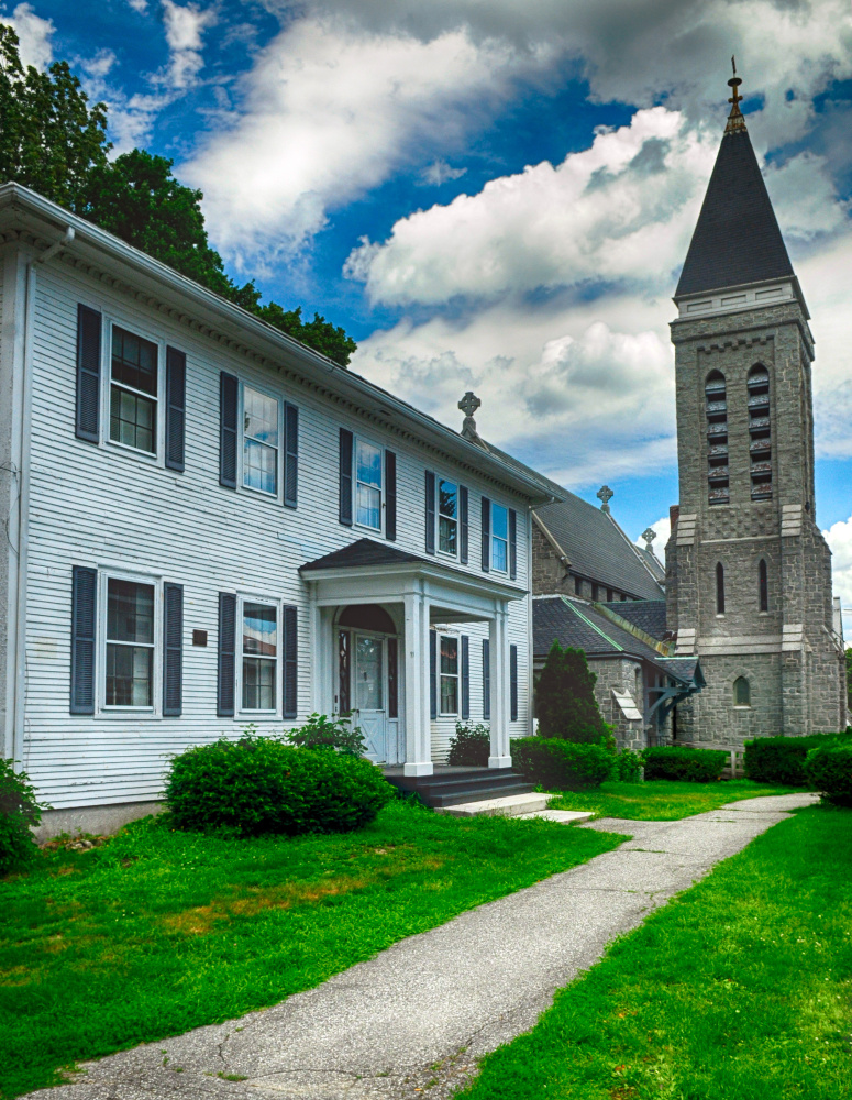 Photo shows the rectory and church building at St. Mark's Episcopal Church campus in Augusta. Both are for sale following the church's decision to focus on its mission rather than continuing to spend money on upkeep.