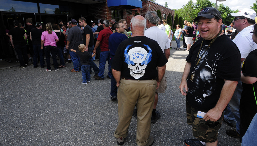 Fans wait to get into the Augusta Civic Center on Sunday for the WWE show.