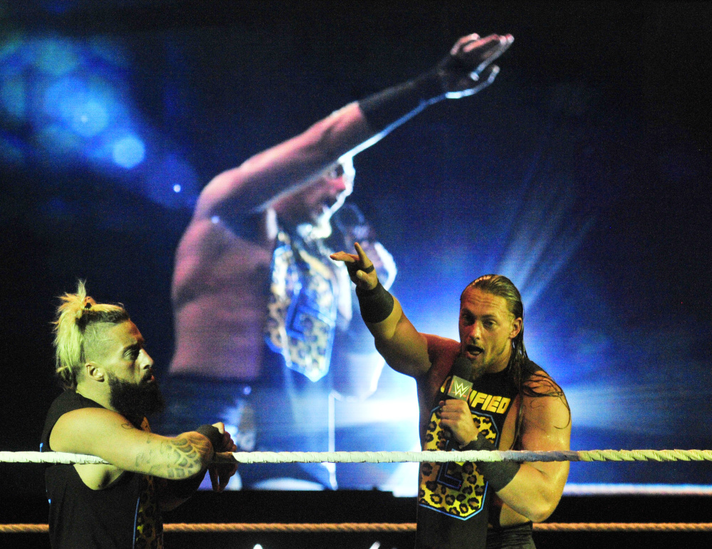 Enzo Amore, left, and Big Cass work the crowd before a tag team match Sunday against the Dudley Boys during the WWE show at the Augusta Civic Center.
