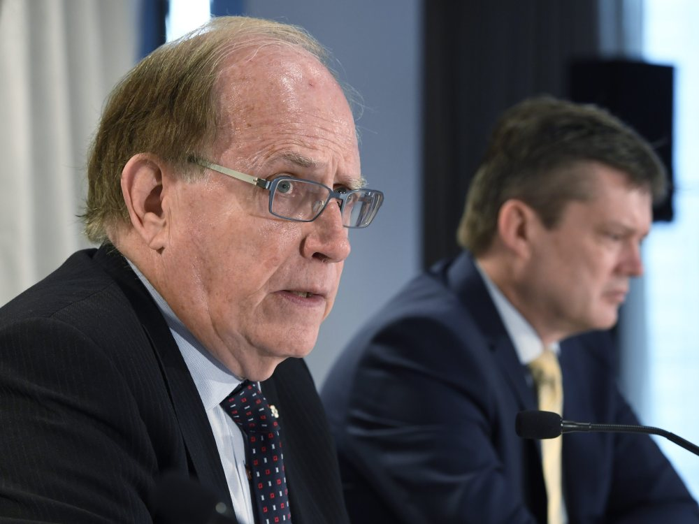Canadian law professor Richard McLaren, left, and investigator Martin Dubbey are shown at a news conference to present McLaren's findings into allegations of a state-backed doping conspiracy involving the 2014 Winter Olympics in Sochi, Russia, in Toronto, Monday, July 18, 2016.