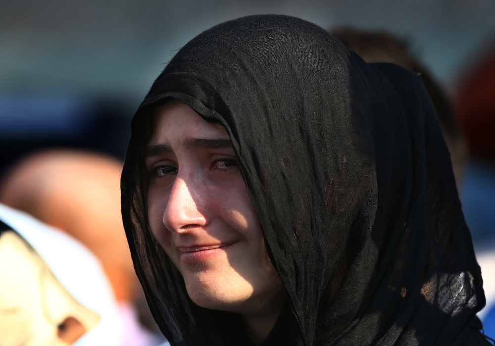A Turkish woman cries Monday at a mass funeral of policemen killed Friday in the failed military coup.