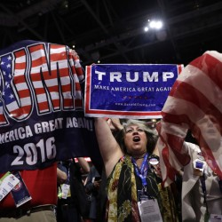 New York delegates cheer Tuesday night at the Republican National Convention in Cleveland, where Donald Trump's home state gave him enough votes to officially make him the party's presidential nominee.
