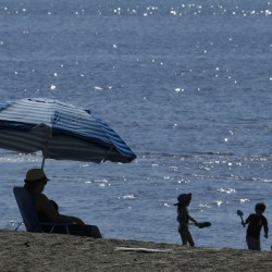 People try to cool off in Alameda, Calif., on Feb. 16. According to the National Oceanic and Atmospheric Administation, June was the 14th straight record hot month globally.