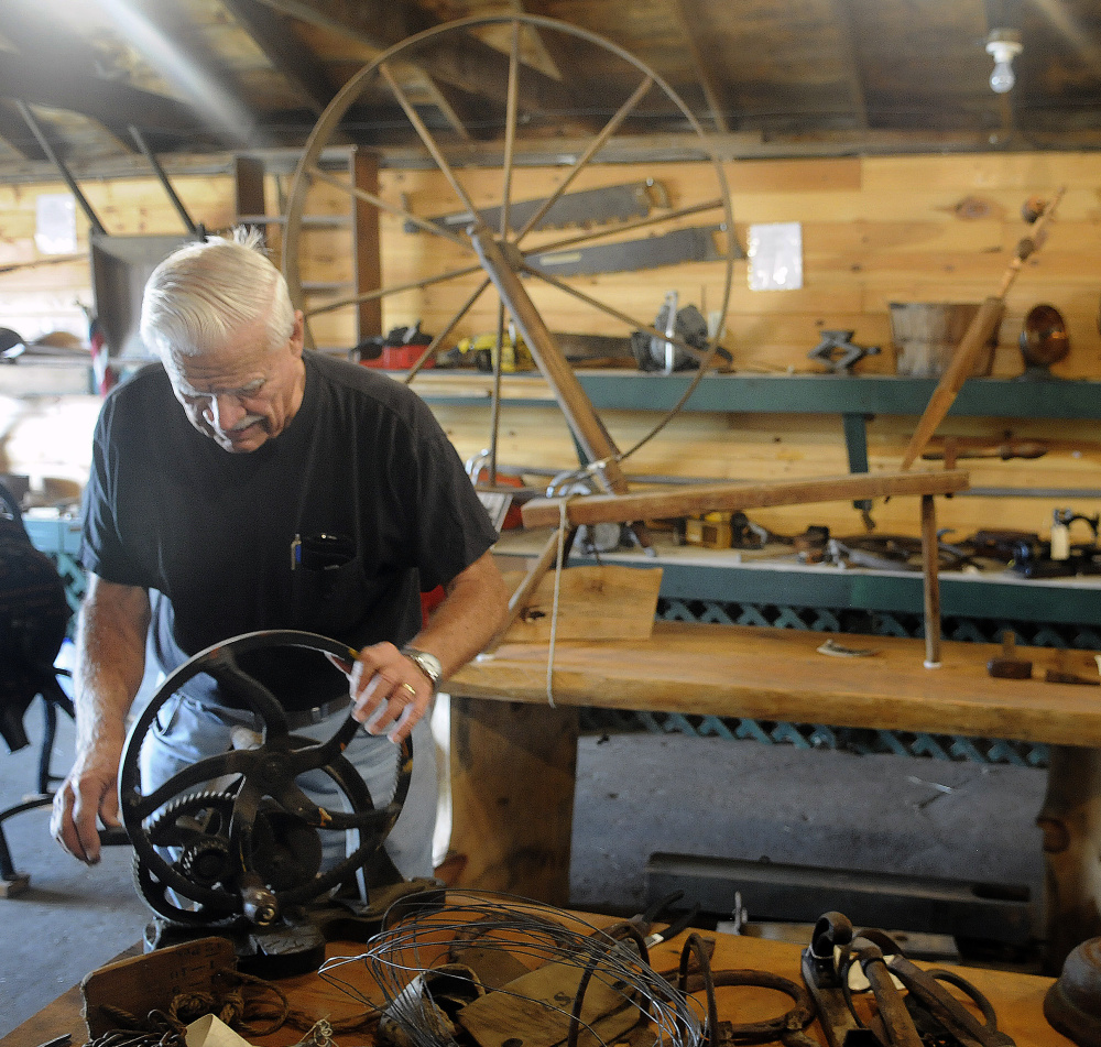Dick Harriman sets up items for display Tuesday in the museum at the Pittston Fair. This weekend's fair begins Thursday with Agricultural Day. Gates open at 8 a.m. daily.