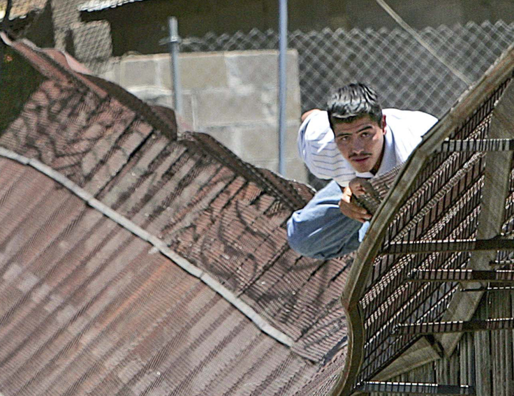 A man climbs over the border into Nogales, Ariz., from Nogales, Mexico, in 2006. People caught crossing the border illegally may face multi-year waits for their courts to hear their cases.