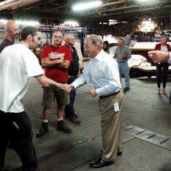 Republican Rep. Bruce Poliquin meets employees of Tasman Leather Group on Wednesday during a tour of the mill in Hartland mill. At right is Norman Tasman, company president and CEO. Poliquin would not comment during his appearance on the Republican Party's nomination of Donald Trump.