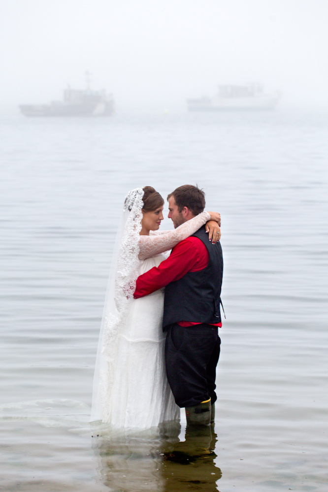 Jon and Melinda Popham mark their wedding vows with a wade into the ocean waters that the lobsterman hoped would finance their future.