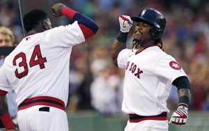 Hanley Ramirez is congratulated by David Ortiz after his two-run home run in the third inning Wednesday night at Fenway Park. Ramirez also hit a two-run homer in the second and later added a two-run blast in the sixth inning against the Giants.