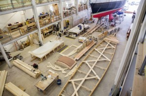 A 65-foot sailboat named Anna, bottom right, is under construction at the Lyman-Morse workshop in Thomaston.