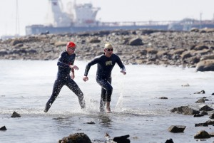 Alex Mukai, right, 18, of Cape Elizabeth, and Scott Yeomans, 52, of Bethlehem, Pennsylvania, race to the finish of the 35th YMCA of Southern Maine Peaks to Portland ocean swim at East End beach in Portland on Saturday.