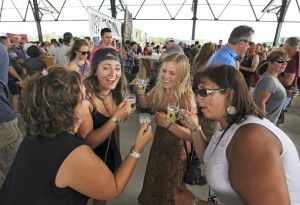 From left, Kathy Usher of Gray, Ana Filipobic of Portland, Lani Edwards of Peaks Island and Jamie Cook of Standish have some fun sampling some of the 250 beers on tap at the Maine Brewers' Guild Summer Session Beer Festival on Saturday.