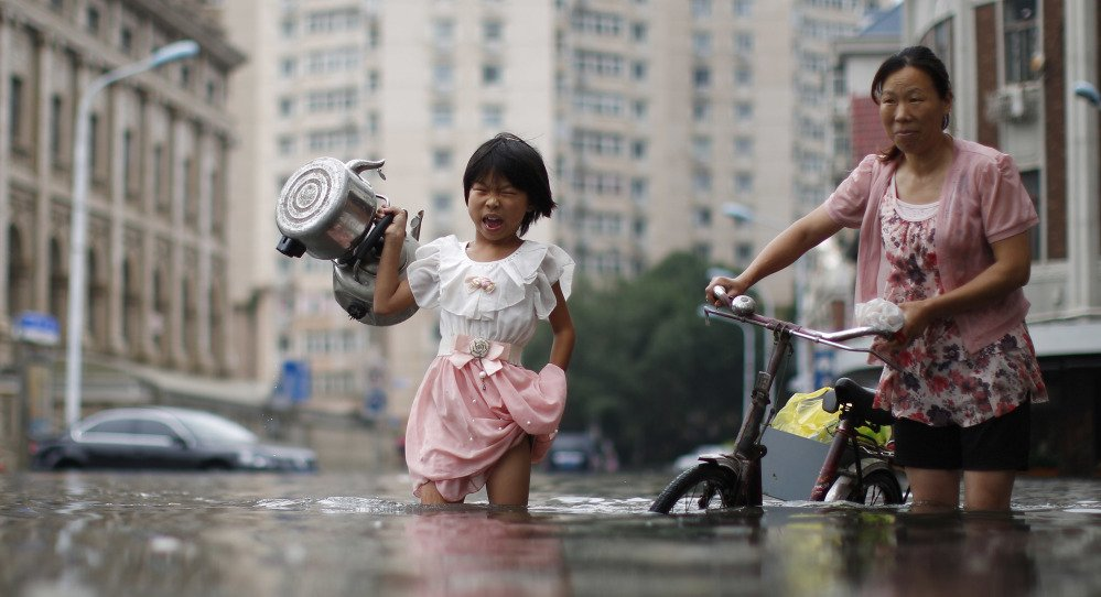 At least 154 people are dead and another 124 are missing in flash flooding and landslides in northern China. Residents of a hard-hit area complained they had no warning.