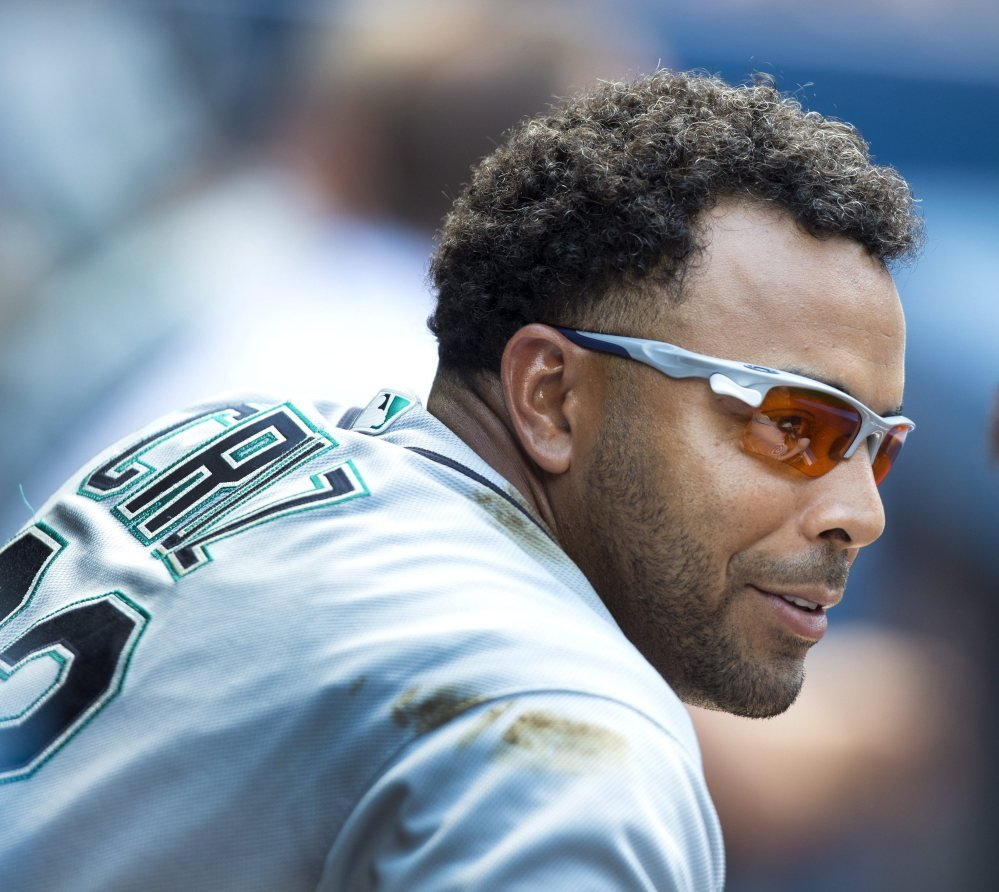 Seattle's Nelson Cruz has reason to smile Saturday after his ninth career grand slam helped the Mariners rout the Blue Jays in Toronto.