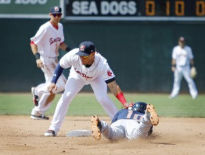 Binghamton's Champ Stuart jars the ball out of the glove of Sea Dogs second baseman Yoan Moncada as he slides in safely for a stolen base in the fifth inning Sunday at Hadlock Field. Stuart went on to score the winning run in a 2-1 victory.