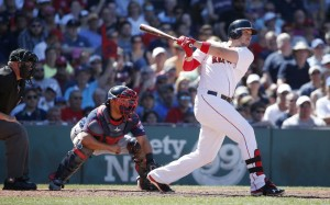 Travis Shaw follows through on a three-run homer in the fifth inning of the Red Sox' 8-7 win over the Minnesota Twins on Sunday in Boston.