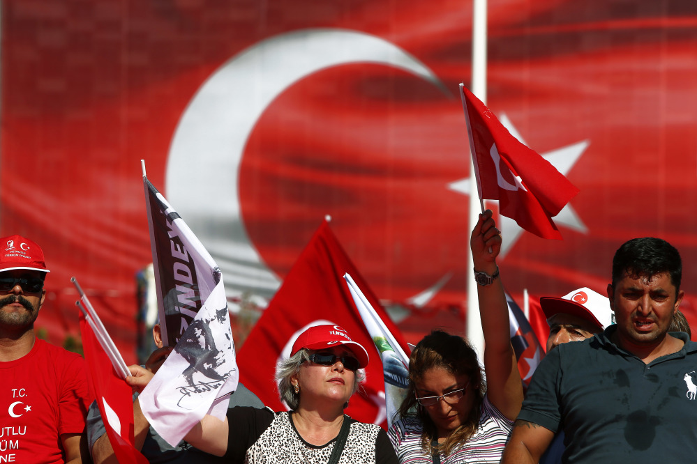 Supporters of the Republican People's Party wave Turkish flags during a 'Republic and Democracy Rally' at Taksim square in central Istanbul on Sunday.