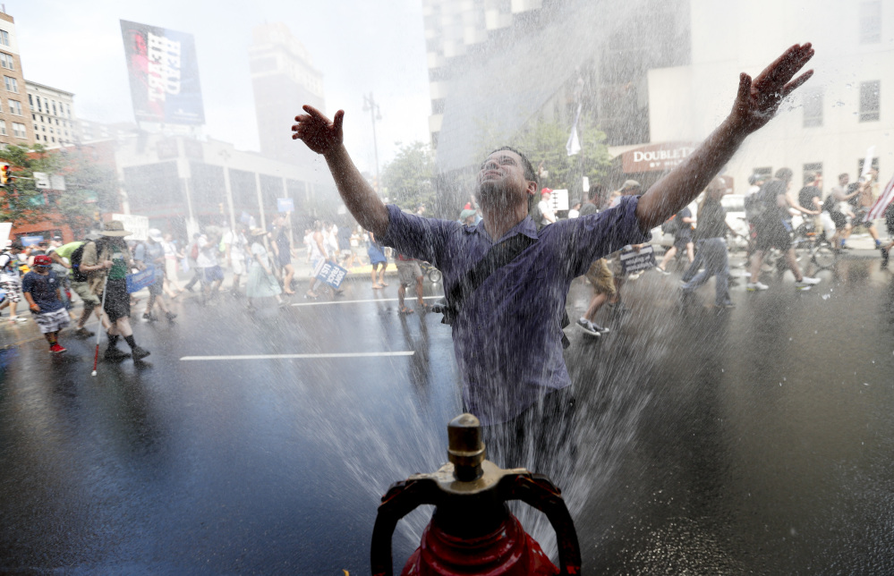 A supporter of Sen. Bernie Sanders, I-Vt., cools off during a march in downtown Philadelphia on Sunday. The Democratic National Convention starts Monday in Philadelphia.