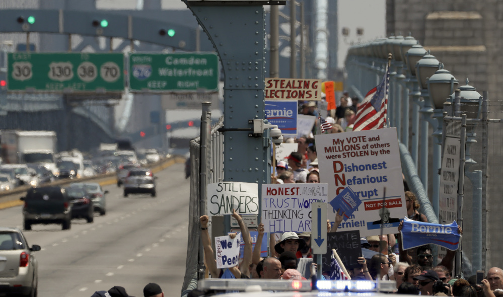 Demonstrators make their way to downtown on the Benjamin Franklin Bridge Monday, July 25, 2016, in Philadelphia, during the first day of the Democratic National Convention.