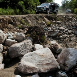 UPPER ENCHANTED TWP.,  ME-  July 25: A delegation of landowners, legislators and other officials travel on the Old Spencer Road in Upper Enchanted Tsp. past an eroded and washed- out section caused by a storm last month on Monday , July 25, 2016. (Photo by David Leaming/Staff Photographer)