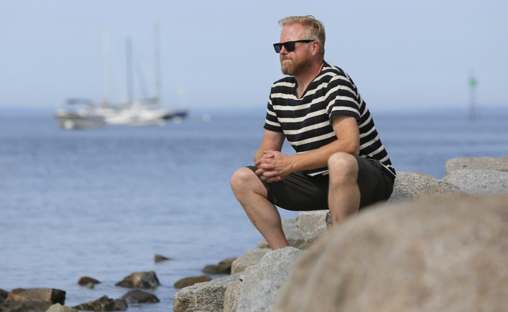 Christopher Betjemann, gazes out at Biddeford Pool on Monday. He will join a sailing expedition to the Arctic Ocean with several missions in mind.