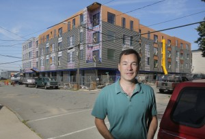 """Developer Jonathan Culley of Redfern Properties is planning a 10-unit townhouse project at 70 Lancaster St. in East Bayside, just up the street from this 53-unit apartment building under construction. """"It's a little risky,"""" he said. """"We see great positive energy in East Bayside."""""""