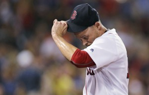 Clay Buchholz heads to the dugout after the eighth inning of the Red Sox' 4-2 loss to the Detroit Tigers on Monday at Fenway Park in Boston.