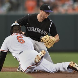 Baltimore's Jonathan Schoop slides into second as Colorado's Trevor Story takes the throw in the Orioles' 3-2 win Monday.